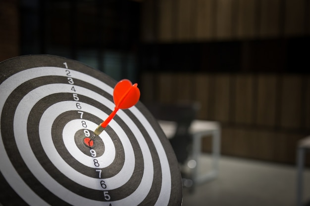 Red dart target arrow hitting on bullseye with,target marketing.