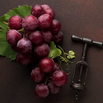 Red delicious grapes and corkscrew