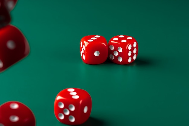Red dice on green background close up