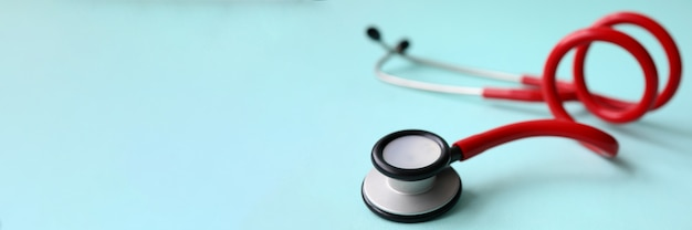Red doctor stethoscope on blue modern background