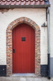 Red door in hause of bruges, belgium