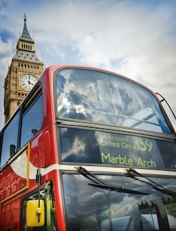 Red double decker bus and big ben in london, uk