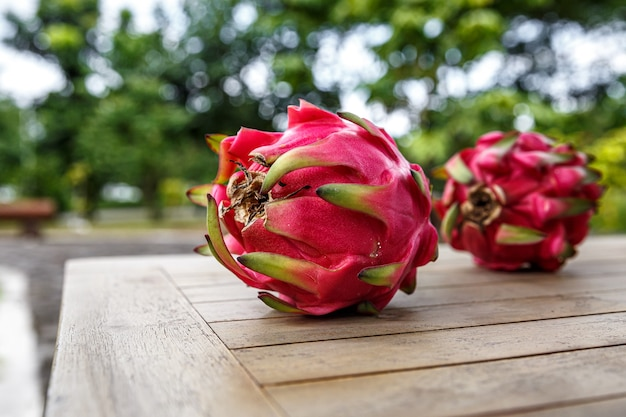 Red dragon fruit on a table.