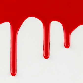 Red dripping paint on white background
