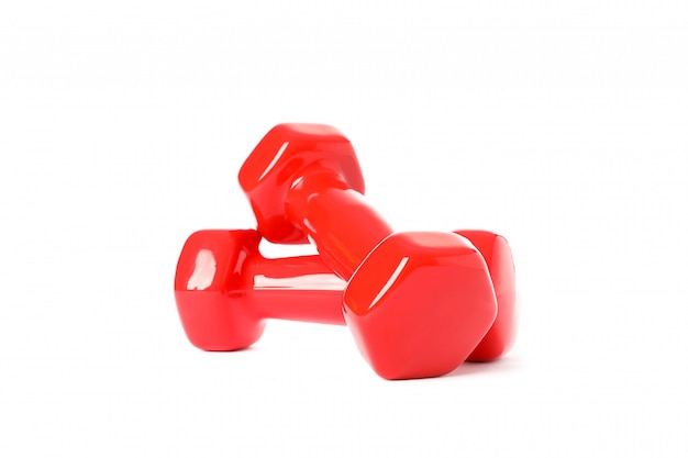 Red dumbbells for fitness isolated on white