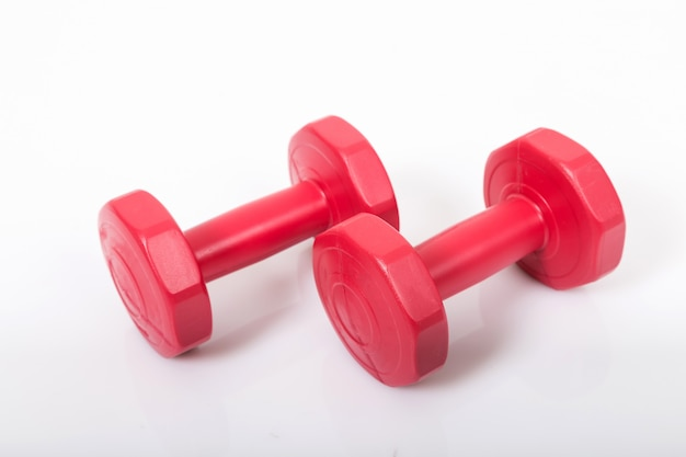 Red dumbells. isolated on a white background