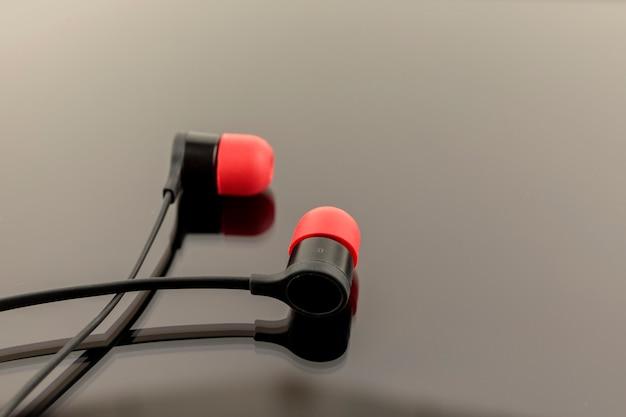 Red earphones on black background