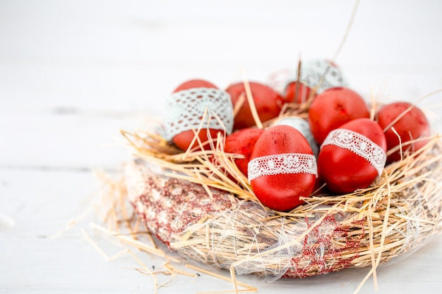 Red easter eggs in a nest of hay