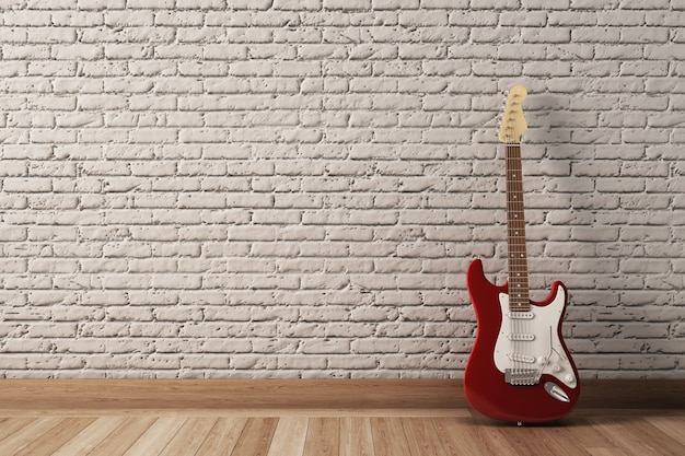 Red electric guitar in interior with white brick wall