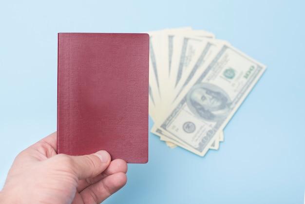 Red empty passport in the man's hand.