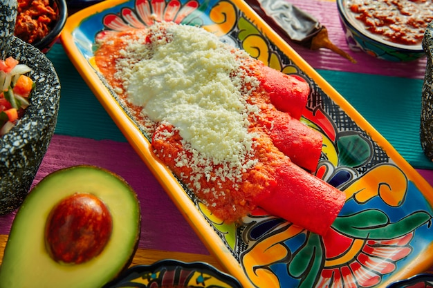 Red enchiladas mexican food with guacamole