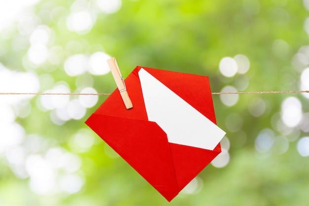 Red envelope greeting card on rope