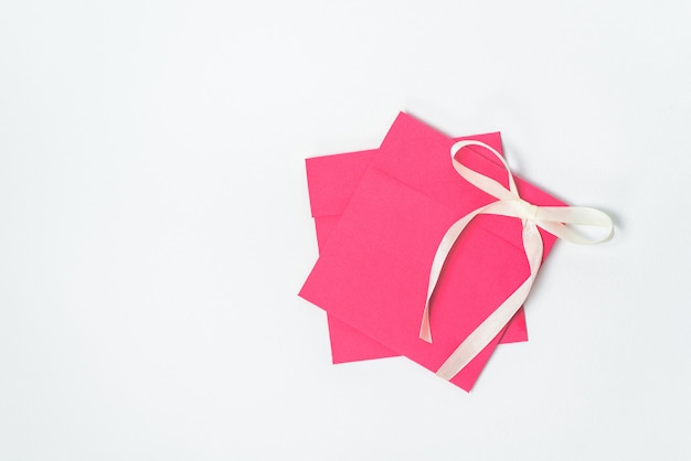 Red envelope with yellow ribbon in the shape of a bow for cd