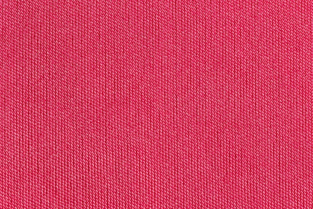Предпосылка текстуры полиэстера ткани красной ткани.