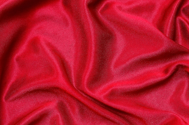 Red fabric cloth texture for background, beautiful crumpled silk or linen.