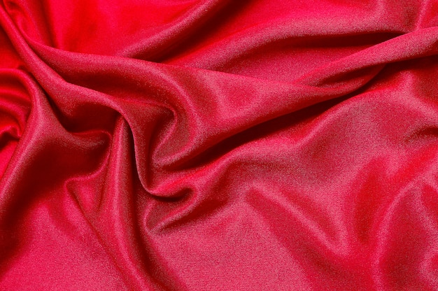 Red fabric cloth texture for background  of silk or linen.