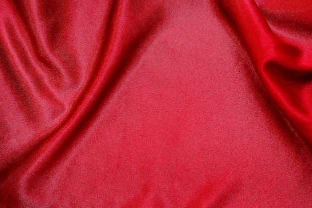 背景の赤い布の布テクスチャ