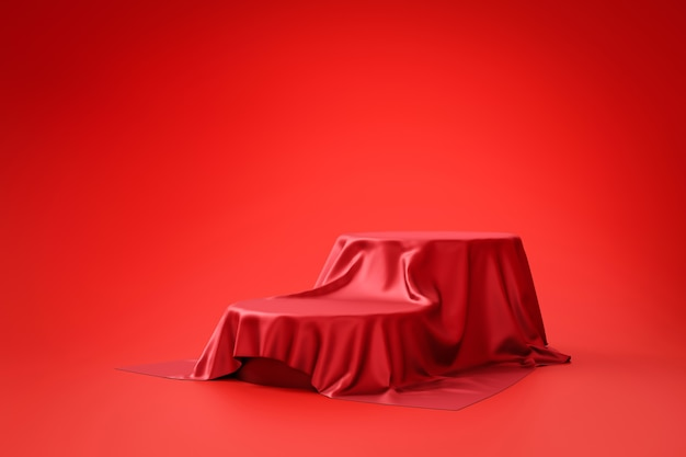 Red fabric and product background stand or podium pedestal on promotional display with blank backdrops. .