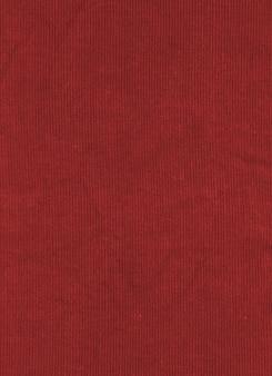 Красная ткань текстуры фона. холст
