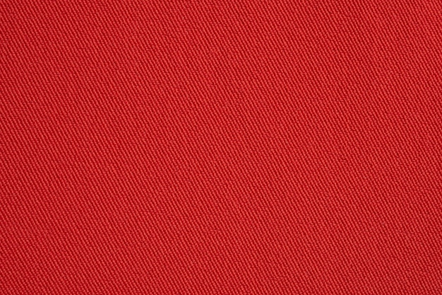 Red fabric texture background close up
