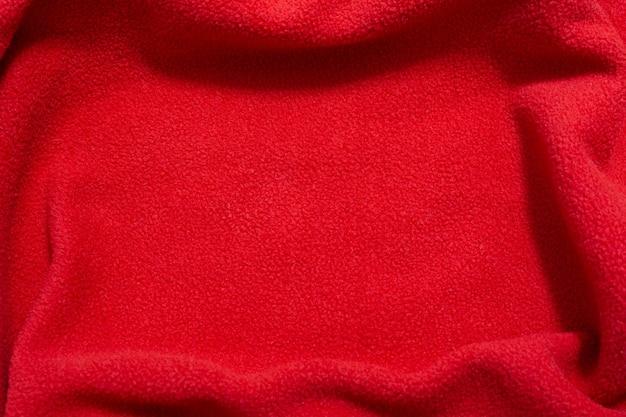 파도 모양에 누워 빨간색 패브릭 질감 배경