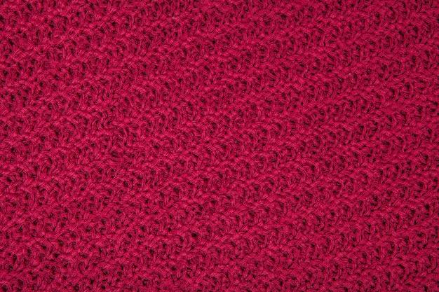 Красная предпосылка текстуры ткани, текстура для дизайна. может использоваться в качестве фона, обоев