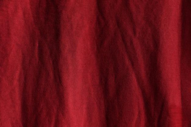 赤い布のテクスチャ表面デザイン