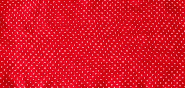 Красная ткань с белым горошком