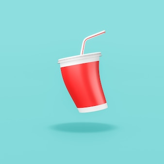 Red fast food drinking cup with straw on blue background