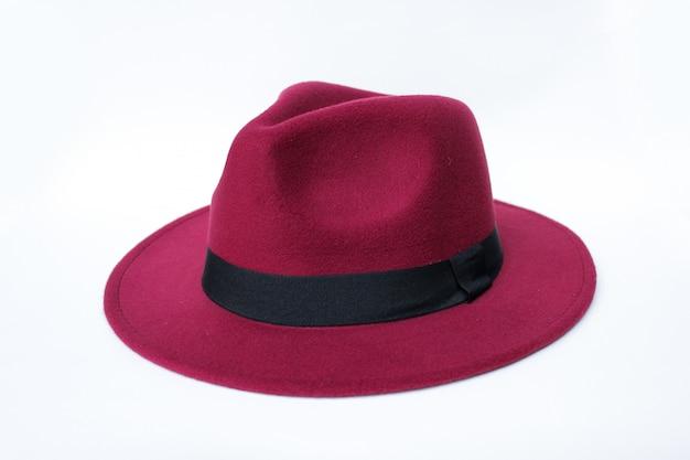 赤いフェドラの帽子 Premium写真