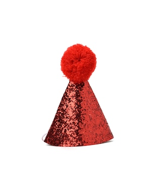 Red festive shiny cone shaped hat with pompom isolated on white background
