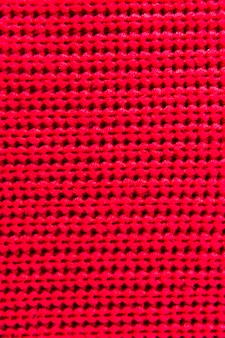 Red fibers with knitted pattern