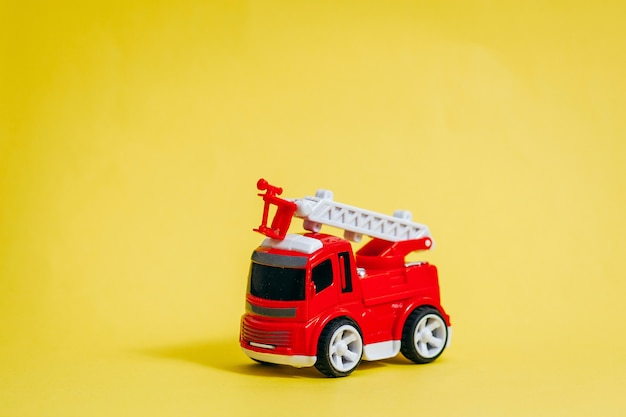 Red fire engine on yellow space