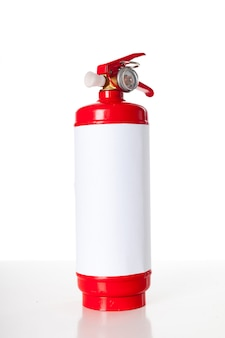 Red fire extinguisher isolated
