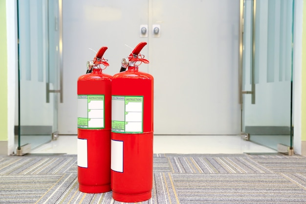 Red fire extinguisher tank in the building.