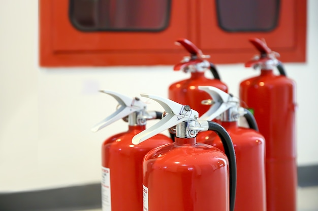 Red fire extinguishers tank in the fire control room for safety and fire prevention