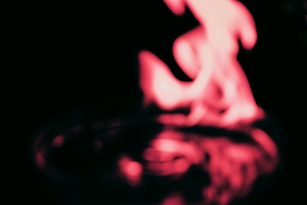 Red fire flame on blur black background
