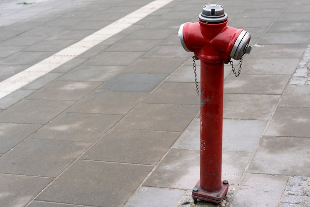 Red fire hydrant in a city street for firefighters