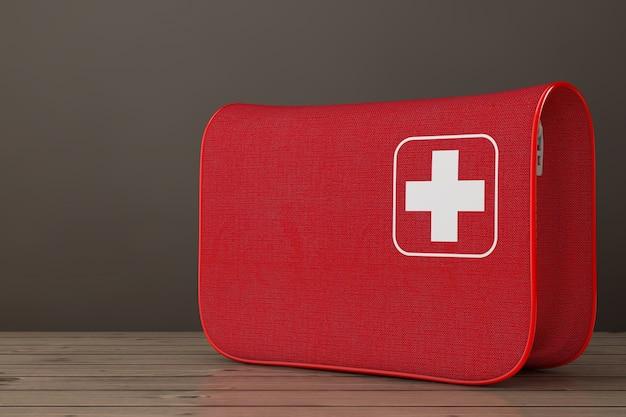 Красная мягкая сумка аптечки с белым крестом на деревянном столе. 3d рендеринг