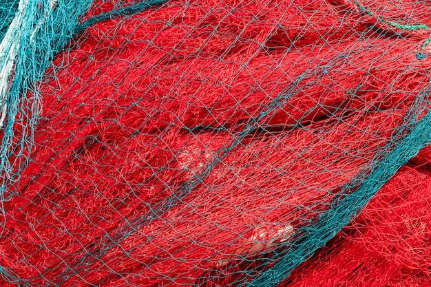 赤い漁網の山の背景テクスチャ極端なクローズアップ