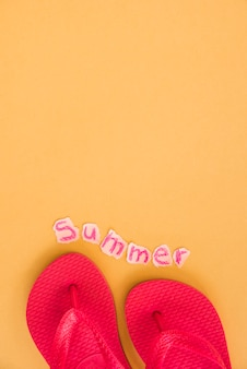 Red flip flops and summer word