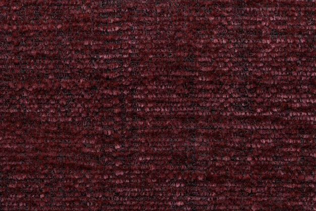 Red fluffy background of soft, fleecy cloth, texture of textile