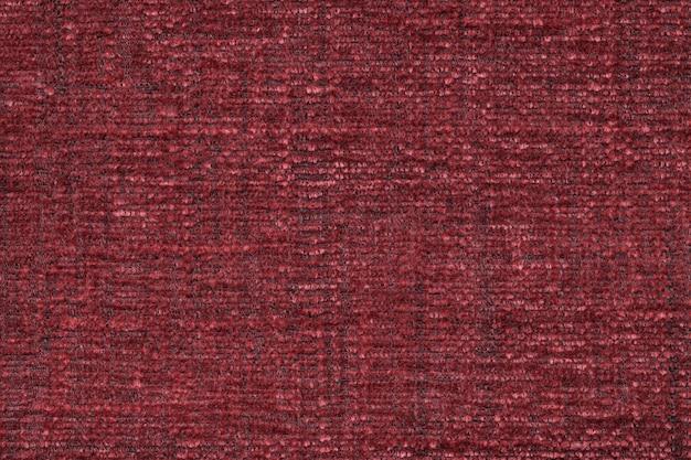 柔らかくふわふわの布の赤いふわふわの表面