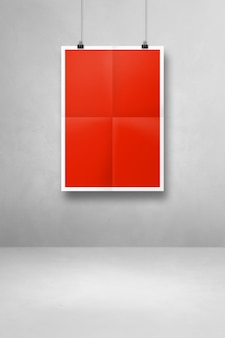 Red folded poster hanging on a white wall with clips. blank mockup template