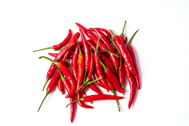 Red fresh chili peppers pattern isolated on white.