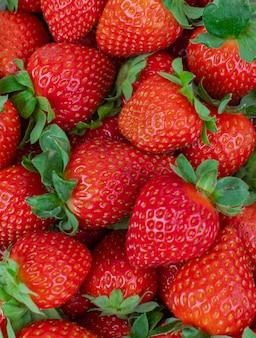 Red fresh ripe strawberries group