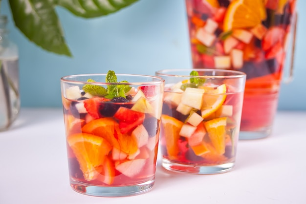 Red fresh sangria with fruits and berries