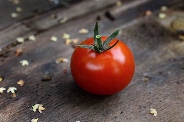 Red fresh tomato on wooden table