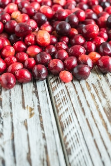 Red fruits on a wooden table