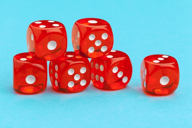 Red gaming dices on blue. game concept.